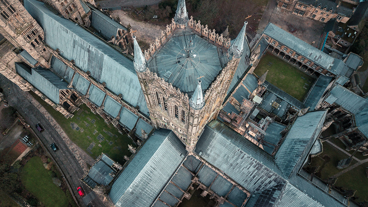 An aerial view of a grand, gothic cathedral.